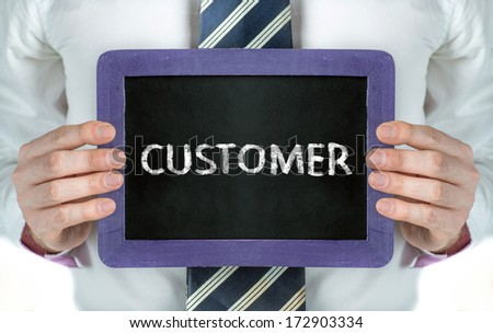 Customer. Business man holding board on the background with business word  - stock photo