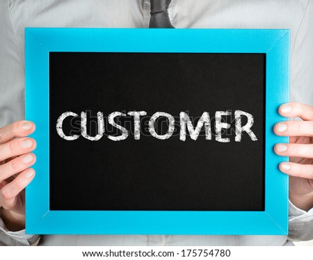 Customer. Business woman holding board on the background with business word  - stock photo
