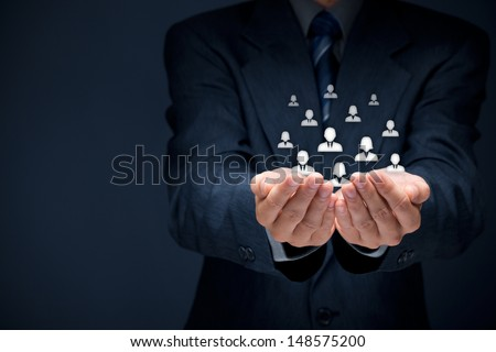 Customer care, care for employees, labor union, CRM, and life insurance concepts. Protecting gesture of businessman or personnel and glass cubes with icons representing group of people. - stock photo