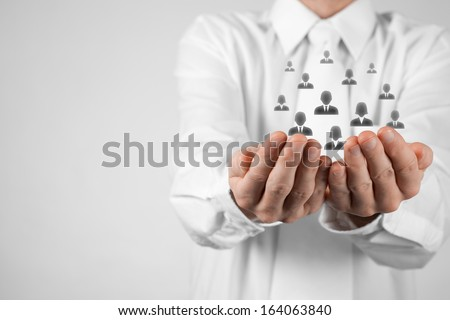 Customer care, care for employees, labor union, CRM, and life insurance concepts. Protecting gesture of businessman or personnel with icons representing group of people. - stock photo