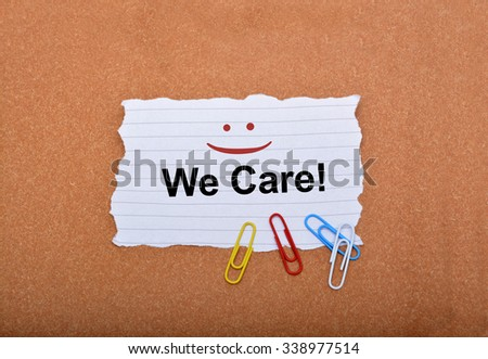 Customer Care sign with smile on paper - stock photo