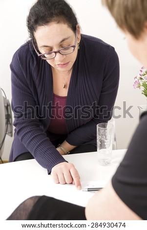 Customer consultation at body treatment clinic - stock photo