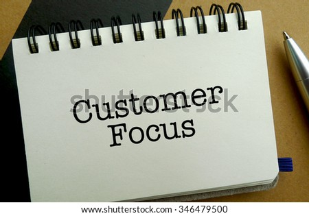 Customer focus memo written on a notebook with pen