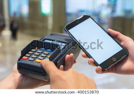 Customer pay the bill by cellphone - stock photo