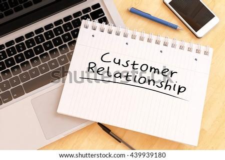 Customer Relationship - handwritten text in a notebook on a desk - 3d render illustration. - stock photo