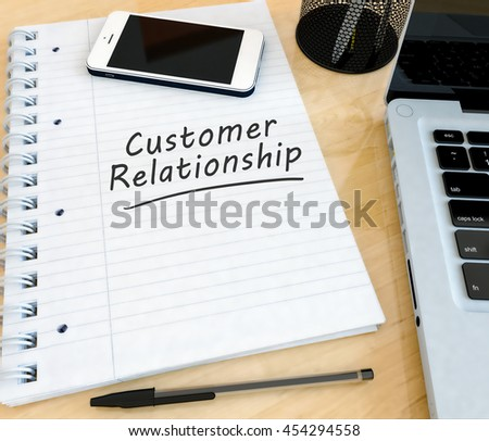 Customer Relationship - handwritten text in a notebook on a desk with laptop and mobilephone- 3d render illustration. - stock photo