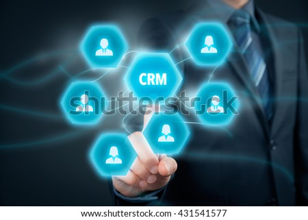 Customer relationship management (CRM) concept. Businessman click on virtual scheme representing CRM.