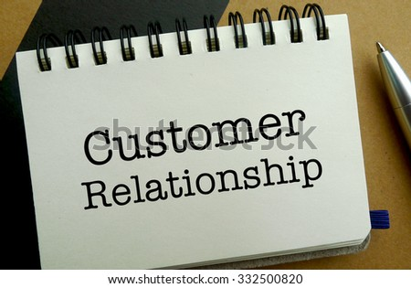 Customer relationship memo written on a notebook with pen - stock photo