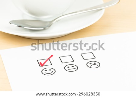 Customer satisfaction survey checkbox with excellent icon tick - stock photo