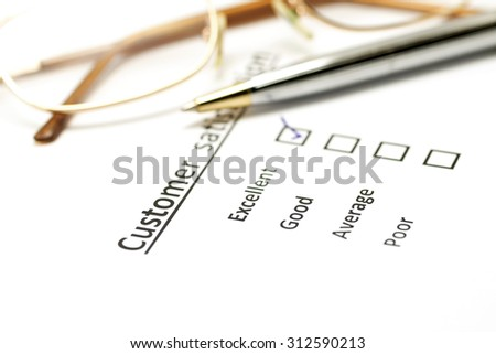 customer satisfaction survey form with the pen and eye glasses