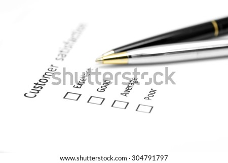 customer satisfaction survey form with the pen pointed to excellent checkbox