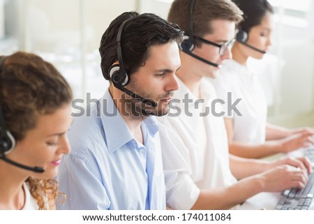Customer service agents working in office - stock photo