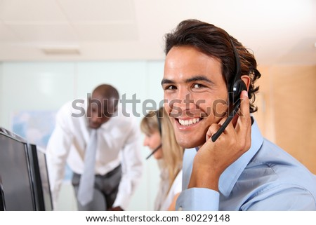 Customer service assistant with headset - stock photo
