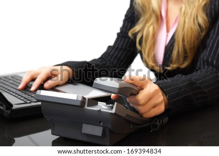customer service concept businesswoman is answering the phone - stock photo