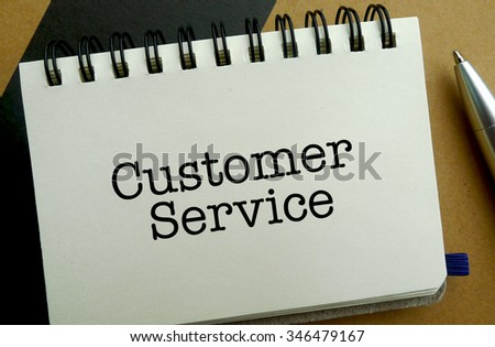 Customer service memo written on a notebook with pen
