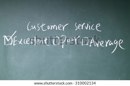 customer service rate sign on blackboard - stock photo