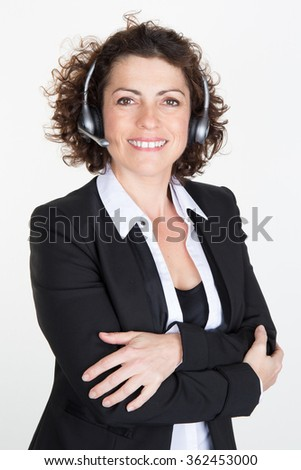 Customer service representative. Confident young woman in headset smiling and keeping her arms crossed while standing isolated on white - stock photo