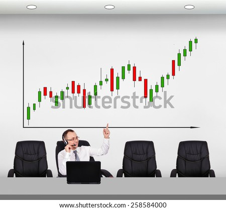customer service representative points a finger at forex chart - stock photo