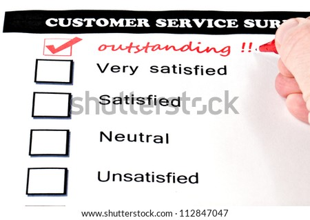 "Customer service survey form. extra checkbox drawn with handwritten word ""outstanding""."