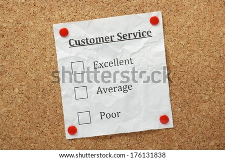 Customer Service Tick Boxes on a piece of crumpled paper pinned to a cork notice board - stock photo