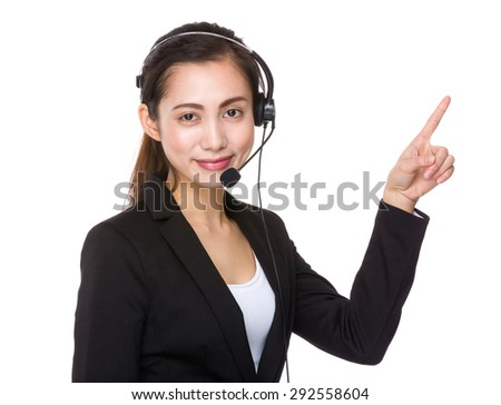 Customer services officer with finger point up - stock photo