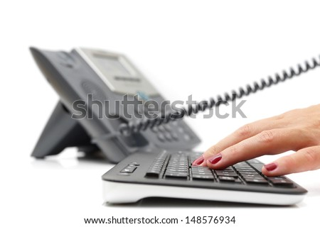 customer support concept with telephone and keyboard - stock photo