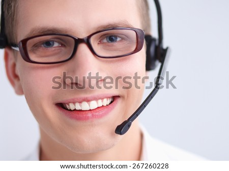 Customer support operator with a headset on white background - stock photo