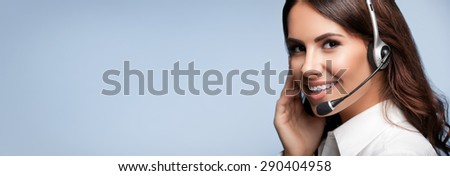 customer support phone operator in headset, with blank copyspace area for slogan or text message, over grey background. Consulting and assistance service call center. - stock photo