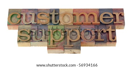 customer support word in vintage wooden letterpress type blocks, stained by color ink, isolated on white