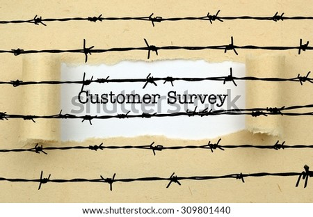 Customer survey text against barbwire - stock photo