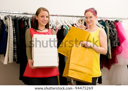 Customer with sales woman in clothing shop