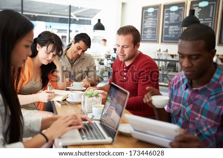 Customers In Busy Coffee Shop - stock photo