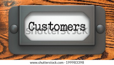 Customers - Inscription on File Drawer Label on a Wooden Background.