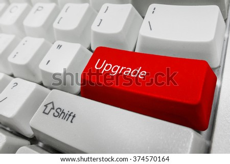 Customized concept with computer enter button on keyboard : Upgrade - stock photo