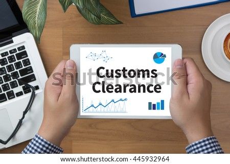 Customs Clearance man hand Tablet and coffee cup - stock photo