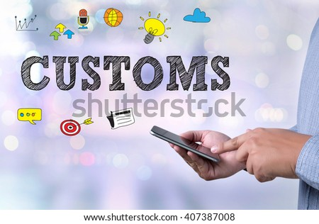 CUSTOMS person holding a smartphone on blurred background - stock photo
