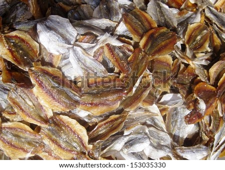 cut and dried smoked fish piled up at an Asian market - stock photo