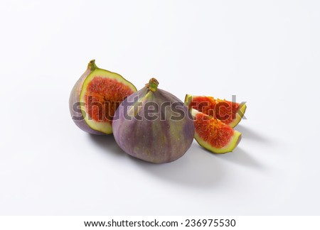 cut and whole fig with red pulp - stock photo