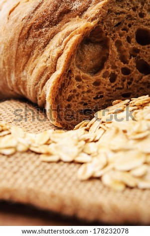 Cut bread and oats on a linen cloth