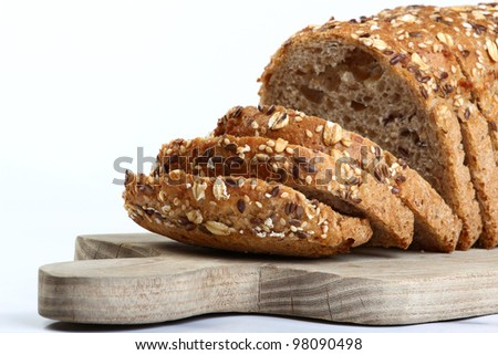 cut bread on cutting wooden board - stock photo