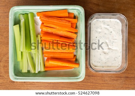 Cut carrots and celery and dip set out for a party.