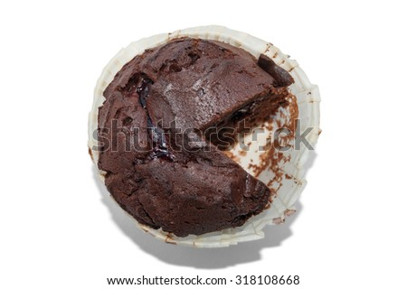 cut chocolate cupcake with cherry inside top view isolated on a white background