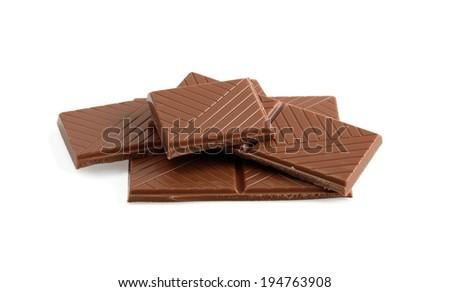 cut chunks of milk chocolate bar on white - stock photo