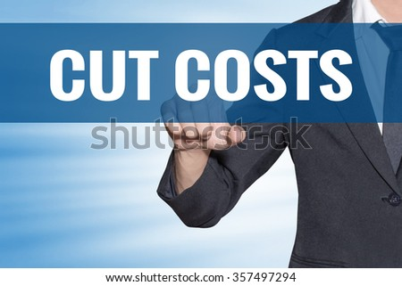 Cut Costs word Business man touching on blue virtual screen - stock photo