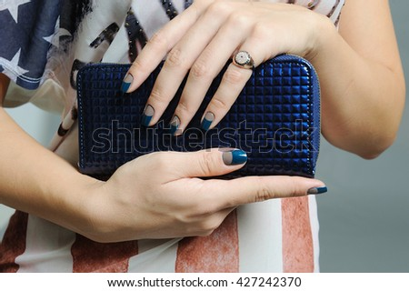 cut face woman and close up in her hands holding a handbag  wearing a glamorous ring and having painted nails - stock photo