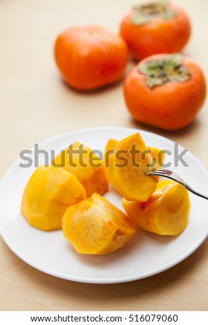 Cut fruit, persimmons with a fork