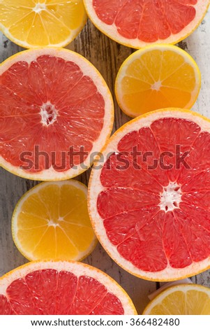 Cut grapefruits lying on the table