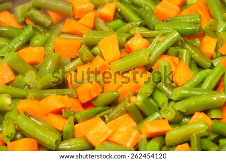 cut green asparagus beans and diced orange carrot - stock photo