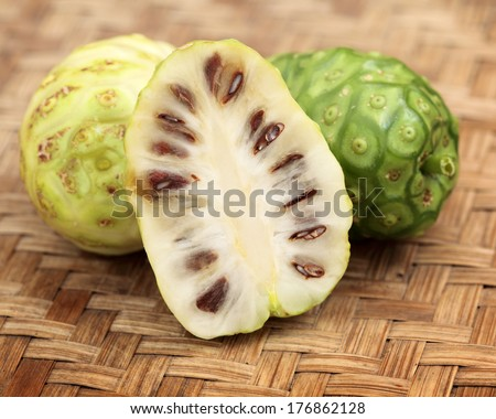 Cut half Noni fruit or Indian Mulberry (Morinda Citrifolia Linn) - stock photo