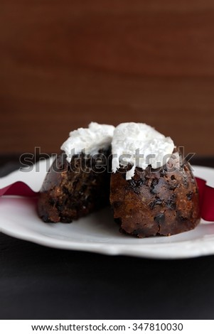 Cut homemade Christmas pudding with icing - stock photo